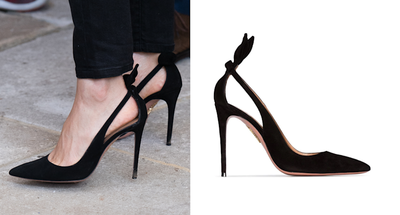 Closeup of Meghan Markle in a pair of black Aquazzura Deneuve pumps.