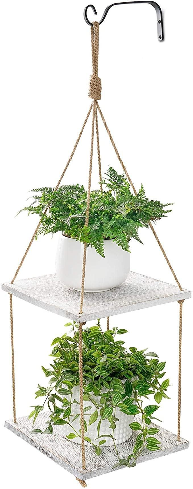 <p>If you have a lot of plants, the <span>POTEY Hanging Plant Shelf 2 Tier Wood Planter Hanger with Jute</span> ($22) might come in handy.</p>
