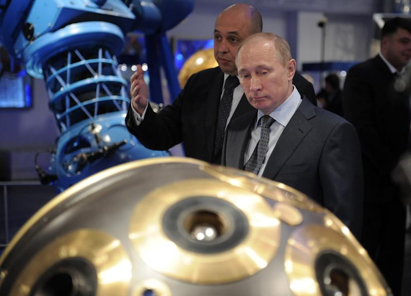 Russian Prime Minister Vladimir Putin, front, visits Moscow's Planetarium in Moscow, Thursday, April 12, 2012. Putin chaired a meeting with officials on building a new space launchpad in Russia's far east that should become operational by 2018. (AP Photo/RIA-Novosti, Alexei Druzhinin, Government Press Service)