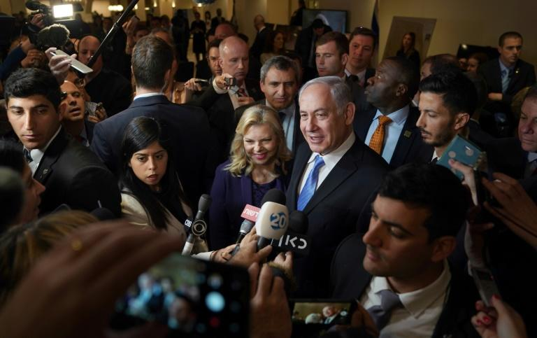 """Israeli Prime Minister Benjamin Netanyahu and his wife Sara Netanyahu talk to the press after they attend an  exhibit entitled """"3000 years of history: Jews in Jerusalem"""" at the Unted Nations"""