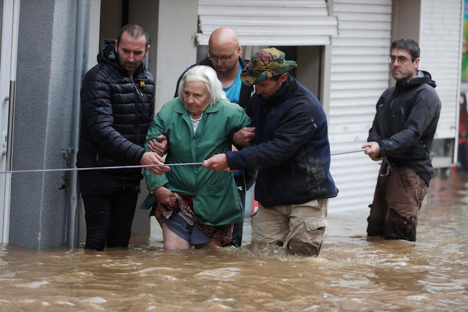 An elderly woman is evacuated after the flooding in the Ensival district of Verviers, Belgium, on Thursday.