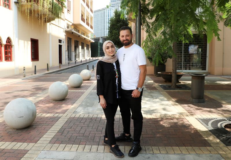 Israa Seblani, a Lebanese doctor and the bride who was caught up in the last year's Beirut port blast during a wedding photoshoot, poses for a picture with her husband Ahmad Subeih