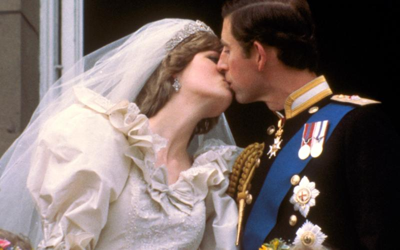 Prince Charles kisses his bride, Princess Diana, on the balcony of Buckingham Palace in London, after their wedding - AP1981