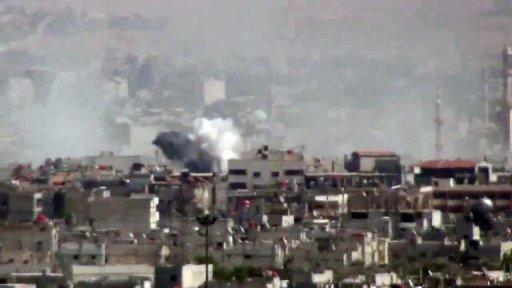 Smoke billows after pro-regime forces shell the Damascus district of al-Qadam