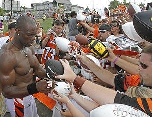 Terrell Owens can still draw a crowd, signing autographs for Bengals fans at training camp in Georgetown, Ky