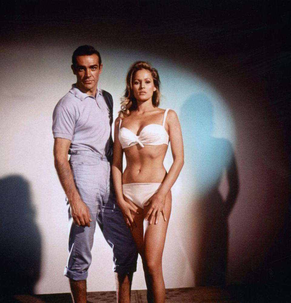 <p>With Ursula Andress in 1962 for <em>Dr. No</em>. </p>