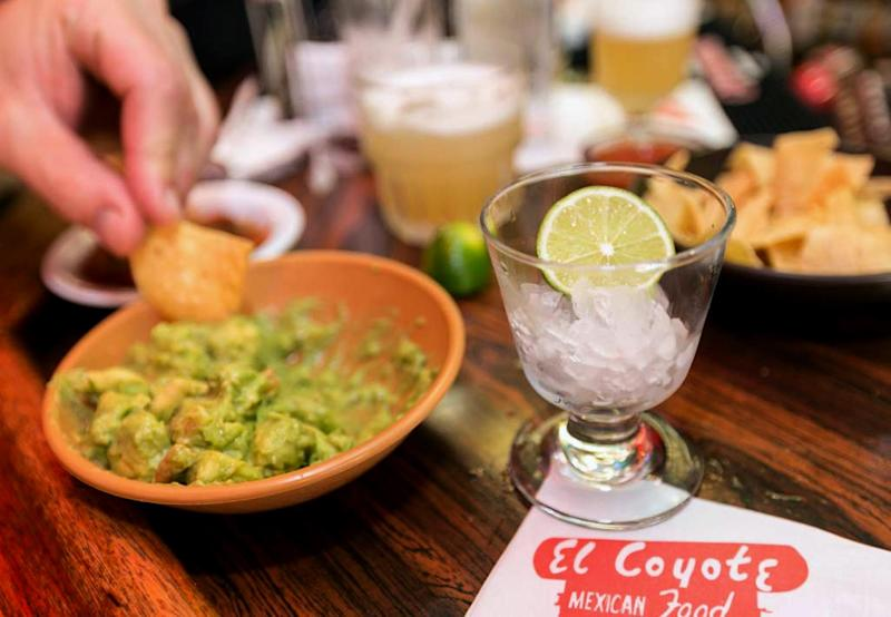 In this Monday, April 28, 2014 photo, a small glass is presented with a lime requested to flavor a guacamole appetizer at the bar of El Coyote, a Mexican restaurant in Los Angeles. Thousands of restaurateurs from coast to coast who have fallen victim to the Great Green Citrus Crisis of 2014. The price of a lime has skyrocketed in recent weeks, quadrupling or, in some areas, going even higher. (AP Photo)