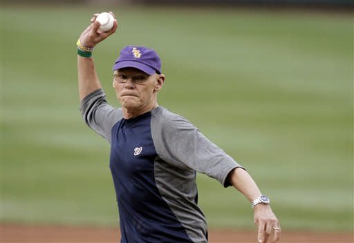 Political consultant James Carville throws out an honorary first pitch before a baseball game between the Washington Nationals and the Atlanta Braves at Nationals Park on Tuesday, Aug. 21, 2012, in Washington. (AP Photo/Alex Brandon)
