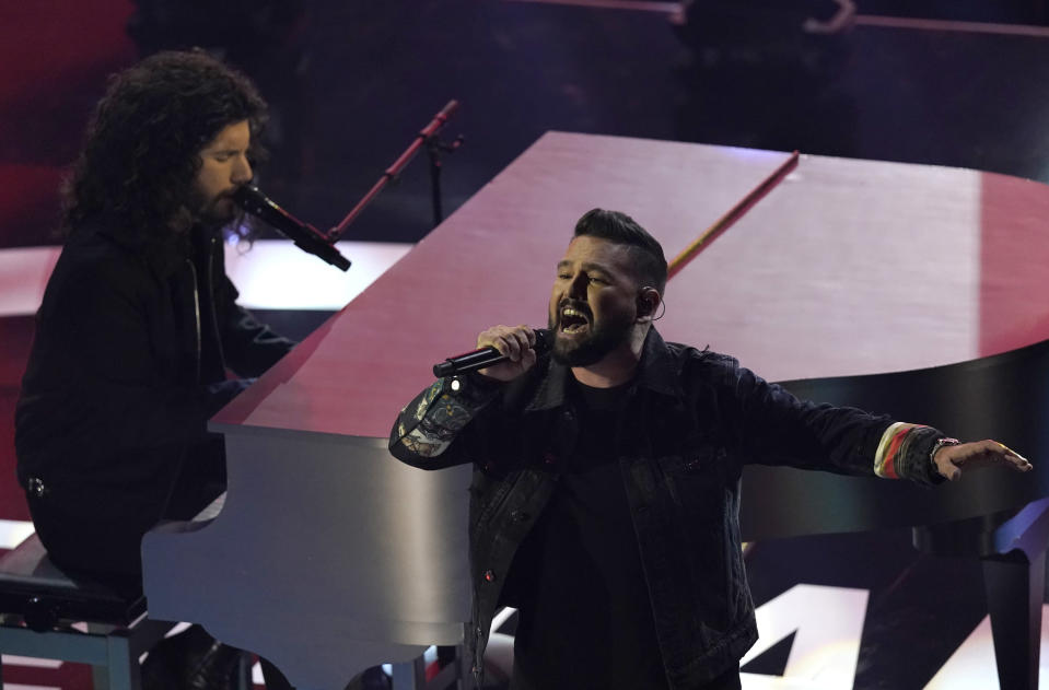 "Dan Smyers, left, and Shay Mooney, of Dan + Shay, perform ""I Should Probably Go to Bed"" at the American Music Awards on Sunday, Nov. 22, 2020, at the Microsoft Theater in Los Angeles. (AP Photo/Chris Pizzello)"