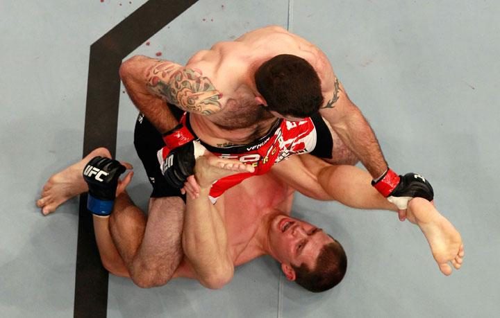 ATLANTA, GA - APRIL 21:  Matt Brown fights for position on top of Stephen Thompson during their welterweight bout for UFC 145 at Philips Arena on April 21, 2012 in Atlanta, Georgia.