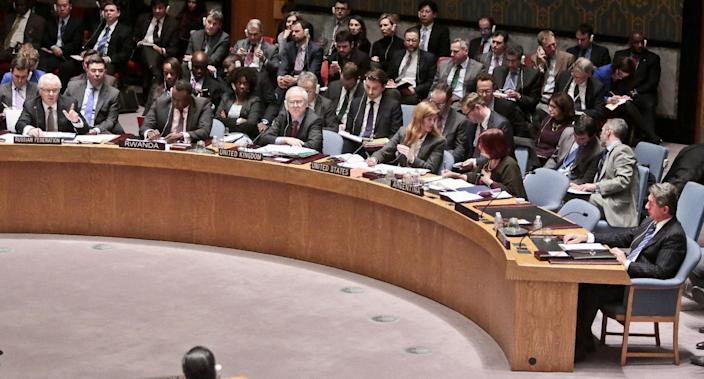 U.N. Russian Ambassador Vitaly Churkin, far left, speaks after listening to U.N. Ukraine Ambassador Yuriy Sergeyev, far right, during a U.N. Security Council meeting on Ukraine, Monday March 3, 2014 at U.N. headquarters. Ukraine's mission to the United Nations claimed Monday that 16,000 Russian troops have been deployed in the strategic Crimea region, while Russia's U.N. ambassador told an emergency Security Council meeting that Ukraine's fugitive president requested them. (AP Photo/Bebeto Matthews)