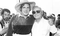 <p>A young Brooks poses with George Jones backstage at Fan Fair in June 1991 in Nashville.</p>