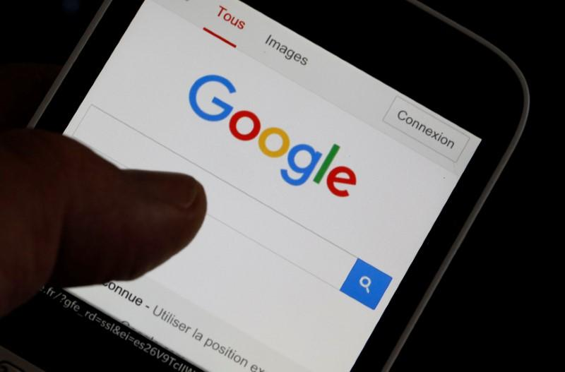 A man holds his smartphone which displays the Google home page, in this picture illustration taken in Bordeaux, Southwestern France