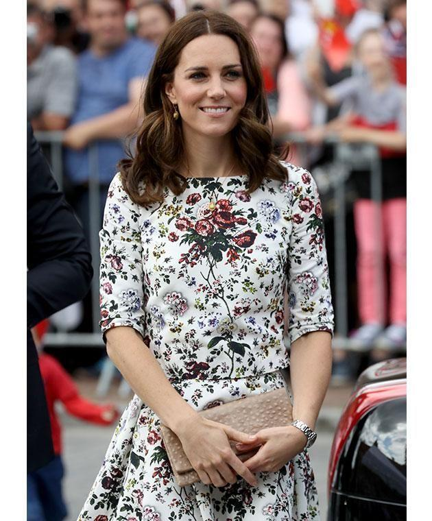 Kate looked elegant in a floral top and skirt combo for day two of their Polish visit. Photo: Getty