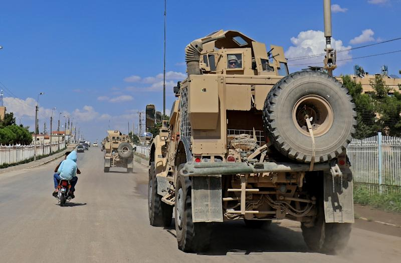 Vehicles of the US-led coalition battling the Islamic State group patrol the town of Rmelane in Syria's Hasakeh province on June 5, 2018 (AFP Photo/Delil souleiman)