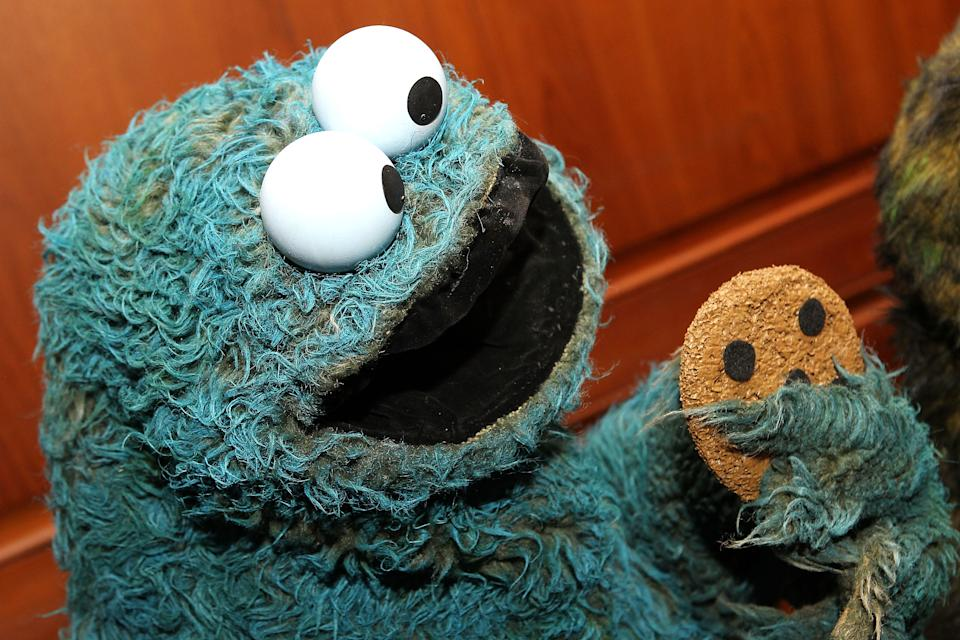WASHINGTON, DC - SEPTEMBER 24:  The Cookie Monster on display at a special National Museum of American History ceremony to receive more than 20 puppets and props from the Henson family on the anniversary of muppet creator Jim Henson's birthday at National Museum Of American History on September 24, 2013 in Washington, DC.  (Photo by Paul Morigi/WireImage)