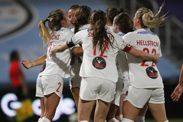 Washington Spirit players celebrate with Sam Staab, who scored a goal against the Portland Thorns during the second half of an NWSL Challenge Cup soccer match at Zions Bank Stadium on Sunday, July 5, 2020, in Herriman, Utah. (AP Photo/Rick Bowmer)