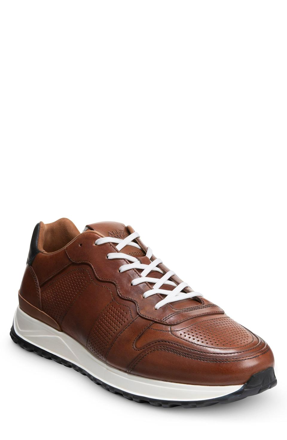 """<p><strong>ALLEN EDMONDS</strong></p><p>nordstrom.com</p><p><strong>$275.00</strong></p><p><a href=""""https://go.redirectingat.com?id=74968X1596630&url=https%3A%2F%2Fwww.nordstrom.com%2Fs%2Fallen-edmonds-lightyear-sneaker-men%2F5913320&sref=https%3A%2F%2Fwww.menshealth.com%2Fstyle%2Fg36283507%2Fmens-dress-sneakers%2F"""" rel=""""nofollow noopener"""" target=""""_blank"""" data-ylk=""""slk:BUY IT HERE"""" class=""""link rapid-noclick-resp"""">BUY IT HERE</a></p><p>This classic brown leather sneaker by Allen Edmonds is complete with perforation for maximum breathability (a feature absent from many of its counterparts). The white laces and white outsole make the tony chestnut leather pop. </p>"""