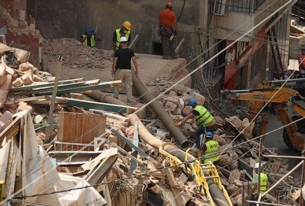 PHOTO: Volunteers and a member of the Chilean rescue team dig through the rubble of buildings which collapsed due to the explosion at the port area, after signs of life were detected, in Gemmayze, Beirut, Lebanon September 5, 2020. (Mohamed Azakir/Reuters)