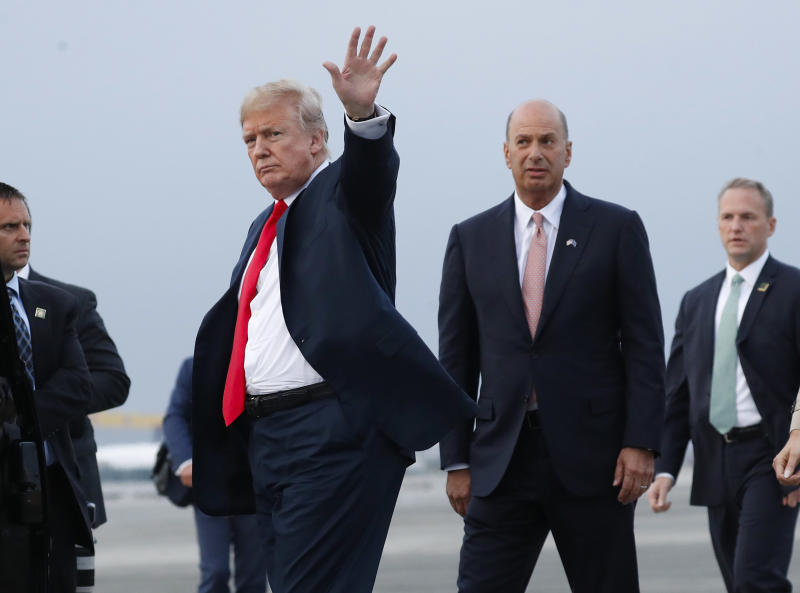FILE - In this Tuesday, July 10, 2018, file photo, President Donald Trump is joined by Gordon Sondland, the U.S. ambassador to the European Union, second from right, as he arrives at Melsbroek Air Base, in Brussels, Belgium. According to text messages released the first week of October 2019 by House investigators, Ambassador Gordon Sondland and Kurt Volker, a former special envoy to Ukraine, discussed Trump wanting to press Ukrainian President Volodymyr Zelenskiy to investigate Trump's Democratic political rival Joe Biden and his family. The House Intelligence Committee is scheduled to meet in private with Sondland. (AP Photo/Pablo Martinez Monsivais, File)