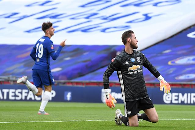 Manchester United goalkeeper David de Gea (right) had a day to forget as Chelsea topped the Red Devils 3-1 to advance to next month's FA Cup final. (Andy Rain/Getty Images)