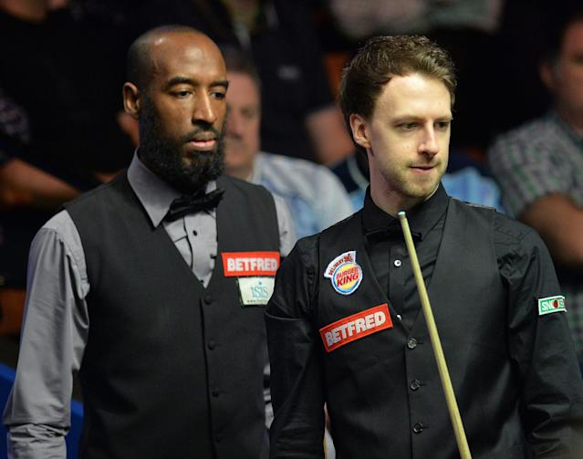 <span>Judd Trump, right, suffered defeat at the hands of qualifier Rory McLeod in the first round of the Betfred World Championship</span>