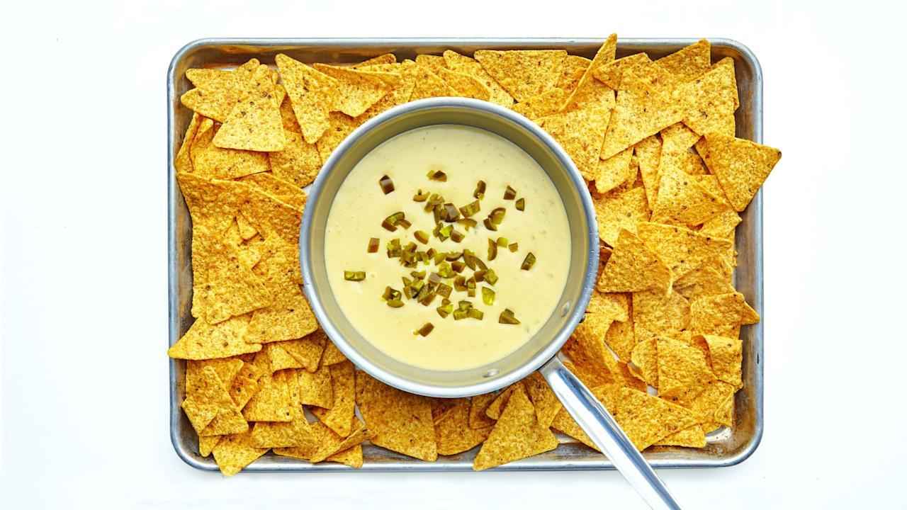"""You could be totally hammered halfway through the Super Bowl and still manage to make this queso. It's a <em>little</em> bit harder than opening up a jar from the grocery store, but the result is a thousand times more delicious. <a href=""""https://www.bonappetit.com/story/the-cheese-problem?mbid=synd_yahoo_rss"""">The American cheese is non-negotiable</a>—it's what helps the queso stay creamy and smooooth—but the Monterey Jack can stay on the sidelines if you'd rather put cheddar, Gruyère, or fontina on the field. (We're trying really hard with the sports metaphor here.) <a href=""""https://www.bonappetit.com/recipe/basically-queso?mbid=synd_yahoo_rss"""">See recipe.</a>"""