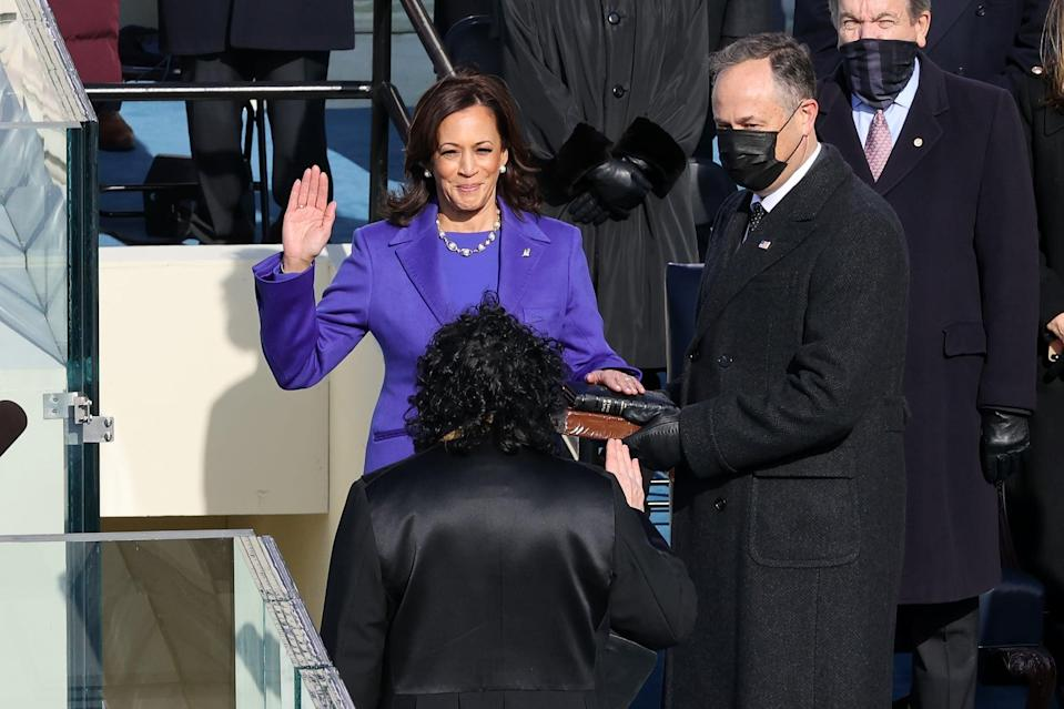 WASHINGTON, DC - JANUARY 20:  Kamala Harris is sworn as U.S. Vice President by U.S. Supreme Court Associate Justice Sonia Sotomayor as her husband Doug Emhoff looks on at the inauguration of U.S. President-elect Joe Biden on the West Front of the U.S. Capitol on January 20, 2021 in Washington, DC.  During today's inauguration ceremony Joe Biden becomes the 46th president of the United States. (Photo by Alex Wong/Getty Images)