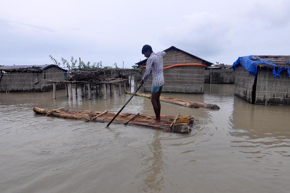 DARRANG ,INDIA-JULY 21,2020: A Villagers row a makeshift raft through a flooded fielde at the flood-affected Puthimari village in Darrang District of Assam ,india - PHOTOGRAPH BY Anuwar Ali Hazarika / Barcroft Studios / Future Publishing (Photo credit should read Anuwar Ali Hazarika/Barcroft Media via Getty Images)