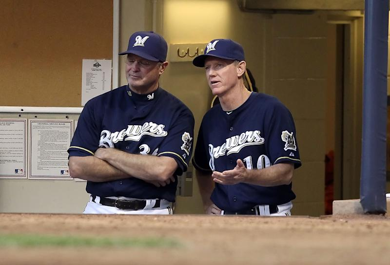MILWAUKEE, WI - OCTOBER 09: Bench coach Jerry Narron and manager Ron Roenicke of the Milwaukee Brewers during Game one of the National League Championship Series against the St. Louis Cardinals at Miller Park on October 9, 2011 in Milwaukee, Wisconsin. The Brewers defeated the Cardinals 9-6. (Photo by Christian Petersen/Getty Images)