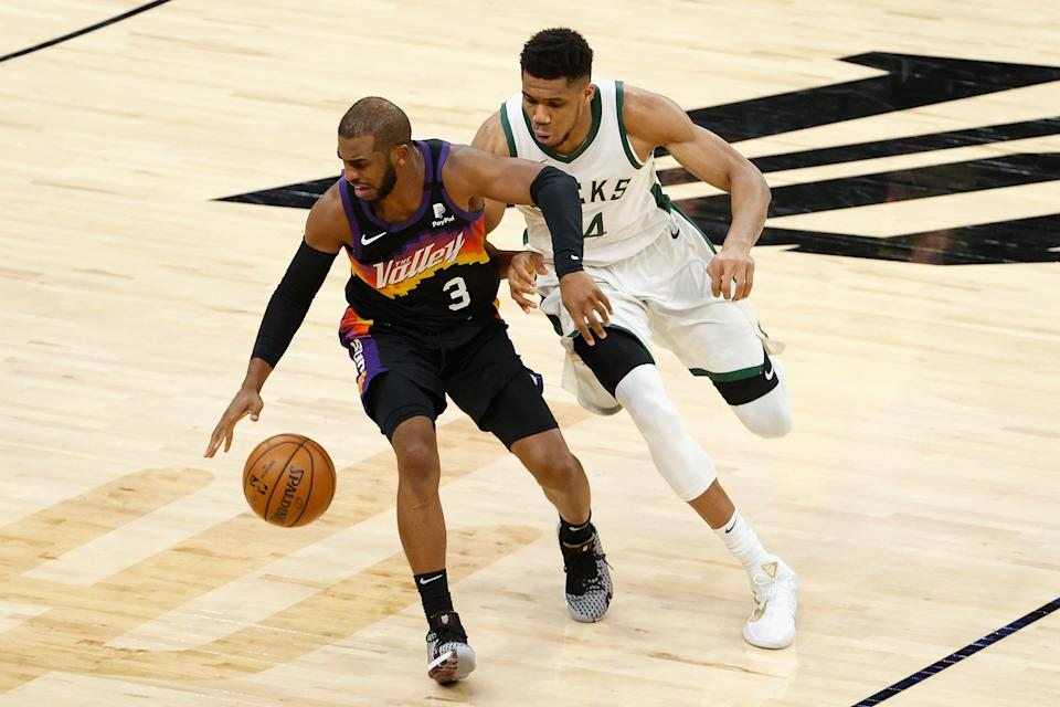 Chris Paul of the Phoenix Suns and Giannis Antetokounmpo of the Milwaukee Bucks are on track to meet in the NBA Finals. (Photo by Christian Petersen/Getty Images)