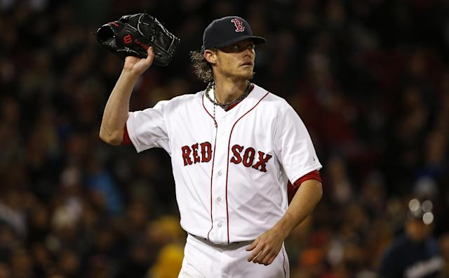 Boston Red Sox starting pitcher Clay Buchholz leaves the mound after giving up three runs to the Milwaukee Brewers during the third inning of a baseball game at Fenway Park in Boston, Saturday, April 5, 2014. (AP Photo/Winslow Townson)