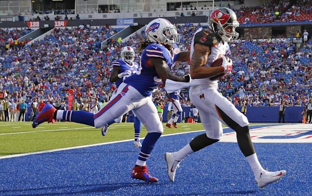 Tampa Bay Buccaneers wide receiver Mike Evans (13) catches a pass for a touchdown in front of Buffalo Bills cornerback Ron Brooks (33) during the first half of a preseason NFL football game Saturday, Aug. 23, 2014, in Orchard Park, N.Y. (AP Photo/Bill Wippert)