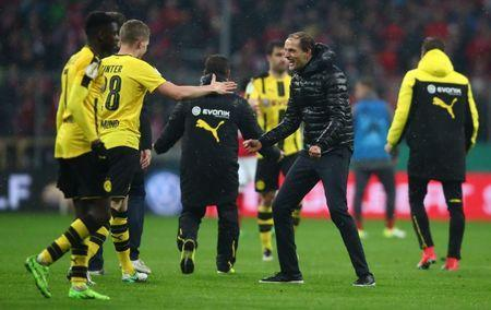Soccer Football - Bayern Munich v Borussia Dortmund - DFB Pokal Semi Final - Allianz Arena, Munich, Germany - 26/4/17 Borussia Dortmund coach Thomas Tuchel and Matthias Ginter celebrate after the match Reuters / Michael Dalder