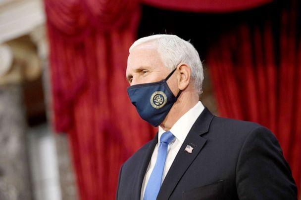 PHOTO: Vice President Mike Pence wears a face mask as participates in mock swearing-in ceremonies for Senators in the Old Senate Chambers at the Capitol Building Jan. 3, 2021. (Kevin Dietsch/Pool via Getty Images)