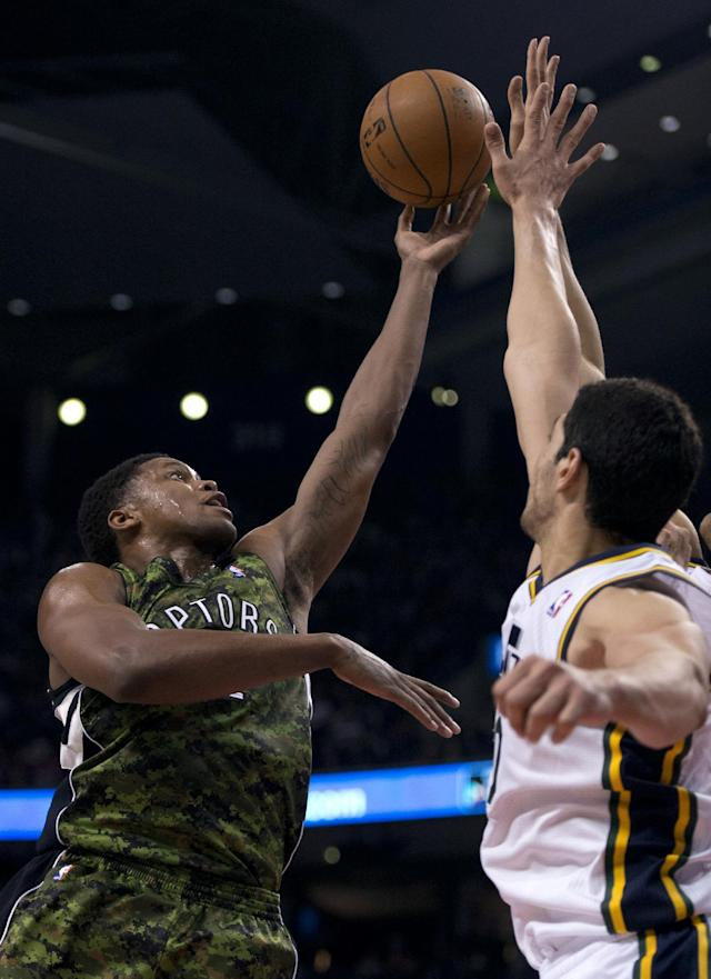 Toronto Raptors forward Rudy Gay, left, drives to the hoop against Utah Jazz's Enes Kanter, right, during the first half of an NBA basketball game in Toronto on Saturday, Nov. 9, 2013. (AP Photo/The Canadian Press, Frank Gunn)