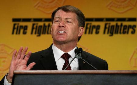 FILE PHOTO - U.S. Senator Mike Rounds (R-SD) speaks at the IAFF Legislative Conference and Presidential Forum in Washington, DC, U.S. on March 9, 2015. REUTERS/Kevin Lamarque/File Photo