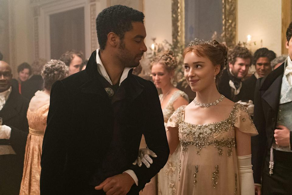 "The Duke of Hastings (Regé-Jean Page, left) romances Daphne Bridgerton (Phoebe Dyvenor) in Netflix series ""Bridgerton."""