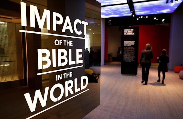 Visitors enter an exhibition at the Museum of the Bible during a preview day.