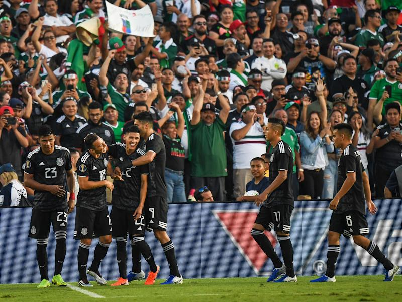 PASADENA, CA - JUNE 15: Uriel Atuna #22 of Mexico celebrates his second goal with Jesus Gallardo #23 of Mexico during the 2019 CONCACAF Gold Cup Group A match between Mexico and Cuba at the Rose Bowl on June 15, 2019 in Pasadena, California. Mexico won the match 7-0 (Photo: Shaun Clark/Getty Images)