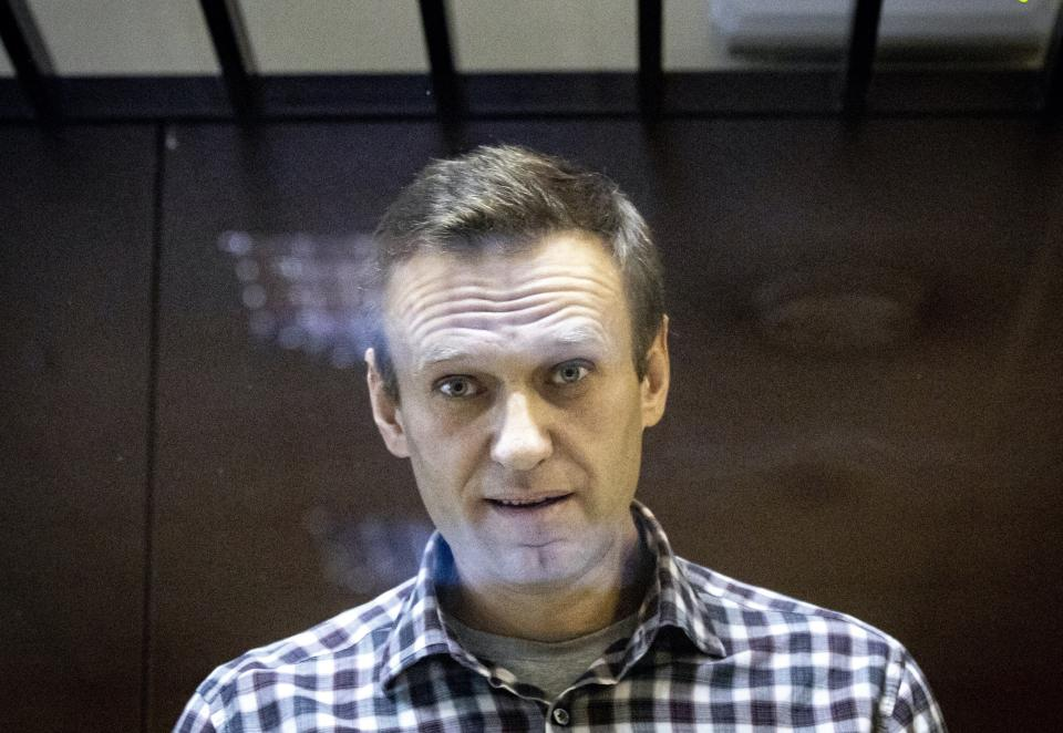 Russian opposition leader Alexei Navalny looks at photographers standing in the Babuskinsky District Court in Moscow, Russia on Feb. 20, 2021. (Alexander Zemlianichenko/AP)