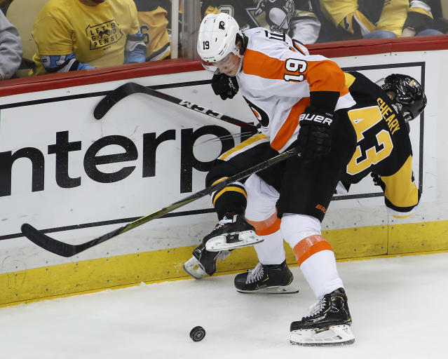 Philadelphia Flyers' Nolan Patrick (19) checks Pittsburgh Penguins' Conor Sheary (43) off the puck during the third period in Game 2 of an NHL first-round hockey playoff series in Pittsburgh, Friday, April 13, 2018. (AP Photo/Gene J. Puskar)