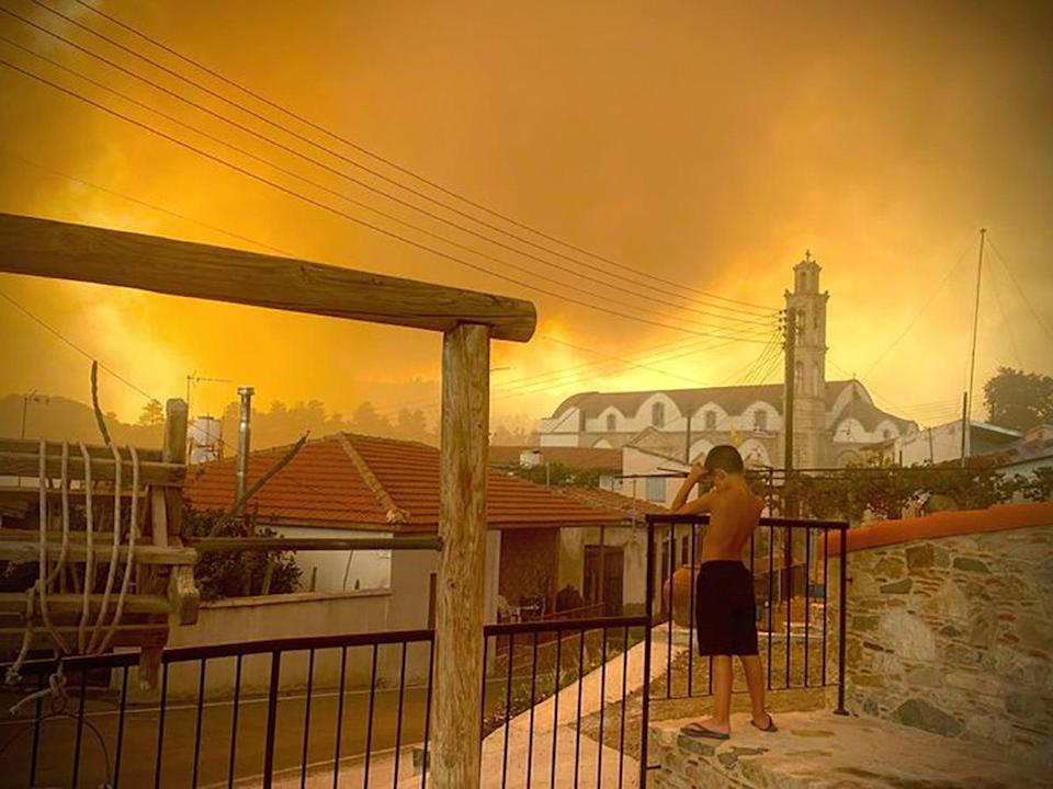 Smoke from a forest fire is seen in Ora village, Larnaca, Cyprus (via REUTERS)