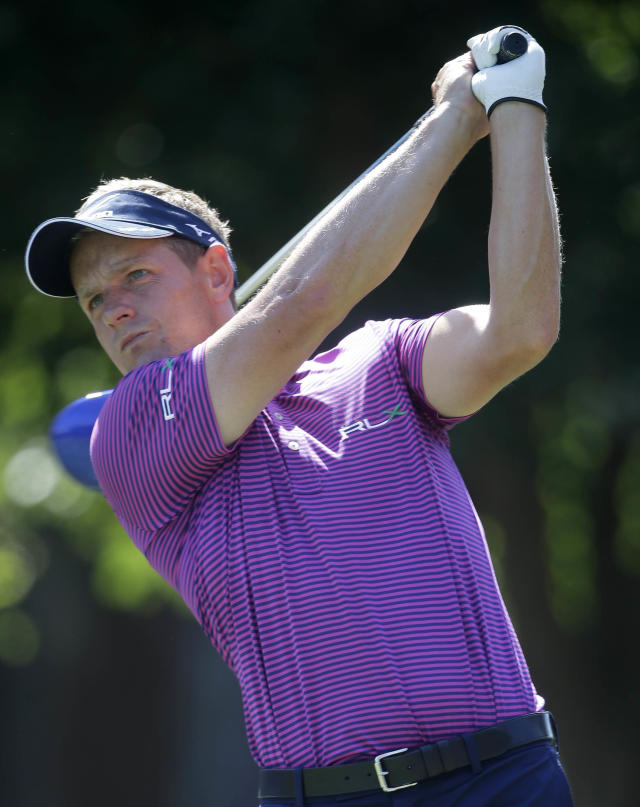 Luke Donald tees off the 9th hole during a practice round for The Players championship golf tournament at TPC Sawgrass in Ponte Vedra Beach, Fla., Wednesday, May 7, 2014. (AP Photo/Gerald Herbert)