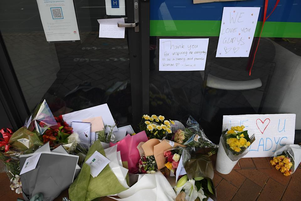 A pile of flowers along with messages outside Gladys Berejiklian's office in Sydney.
