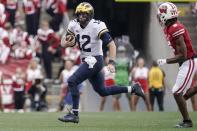 Michigan's Cade McNamara* runs during the second half of an NCAA college football game Saturday, Oct. 2, 2021, in Madison, Wis. (AP Photo/Morry Gash)