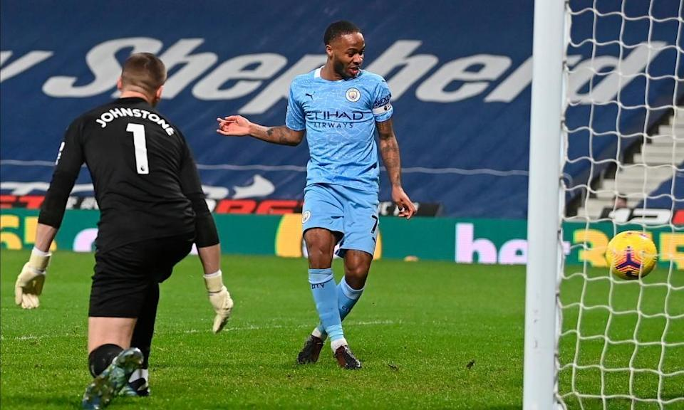 Raheem Sterling scores Manchester City's fifth goal.