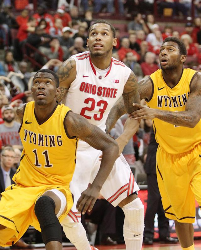 Ohio State's Amir Williams (23) is blocked out by Wyoming's Derek Cook, Jr. (11) and Charles Hankerson (1) during the second half of an NCAA college basketball game, Monday, Nov. 25, 2013, in Columbus, Ohio. (AP Photo/Mike Munden)