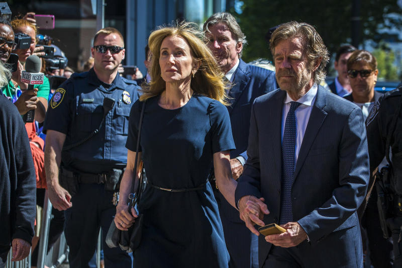 BOSTON, MA - SEPTEMBER 13: Felicity Huffman arrives with her husband William H. Macy at John Joseph Moakley US Courthouse in Boston on Sept. 13, 2019. (Photo by Nic Antaya for The Boston Globe via Getty Images)