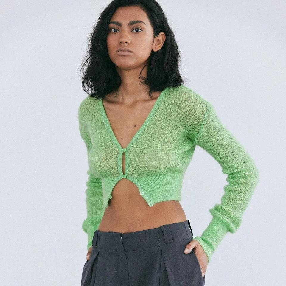 """Couple this soft mohair knit with high-waisted trousers if you're not quite ready for a full curtain reveal. (Extra style points if the bottoms <a href=""""https://www.glamour.com/story/puddle-pants-trend?mbid=synd_yahoo_rss"""" rel=""""nofollow noopener"""" target=""""_blank"""" data-ylk=""""slk:puddle"""" class=""""link rapid-noclick-resp"""">puddle</a> at the ankle for a <a href=""""https://www.glamour.com/story/maeve-reilly-street-style-secret-weapon?mbid=synd_yahoo_rss"""" rel=""""nofollow noopener"""" target=""""_blank"""" data-ylk=""""slk:celeb-approved outfit formula"""" class=""""link rapid-noclick-resp"""">celeb-approved outfit formula</a>.) $95, Source Unknown. <a href=""""https://thesourceunknown.com/collections/knitwear/products/fuzzy-crop-mohair-cardigan-shanmrock"""" rel=""""nofollow noopener"""" target=""""_blank"""" data-ylk=""""slk:Get it now!"""" class=""""link rapid-noclick-resp"""">Get it now!</a>"""